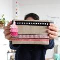 Creative idea: customize a sleeve with stripes and a triple pompom