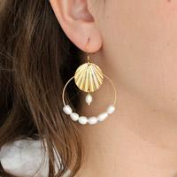 a54e2eb8efa9 Seashell entrepierna y perlas de agua dulce.