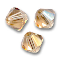 Toupies en cristal Swarovski 4 mm Light Colorado Topaz  x50