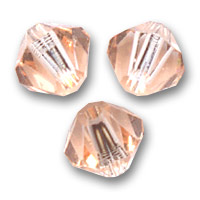 Toupies en cristal Swarovski 4 mm Light Peach  x50